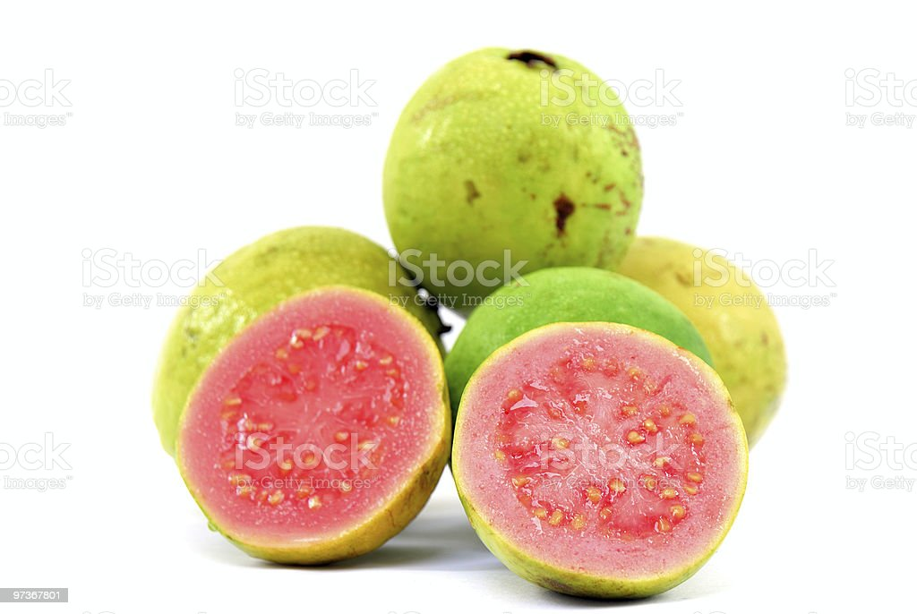 Pile of guavas with a cut open guava in front  stock photo