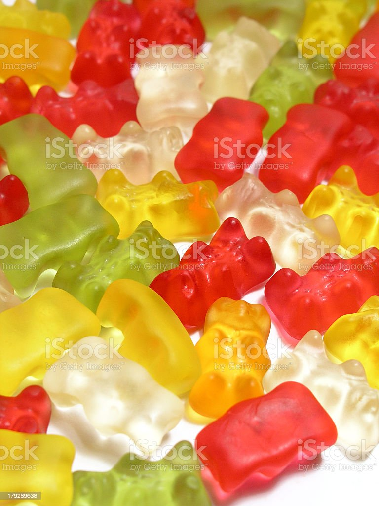Pile of gummy bears on the white surface  stock photo