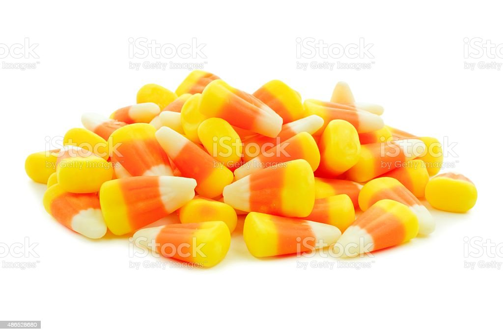 Pile of Halloween candy corn over white stock photo