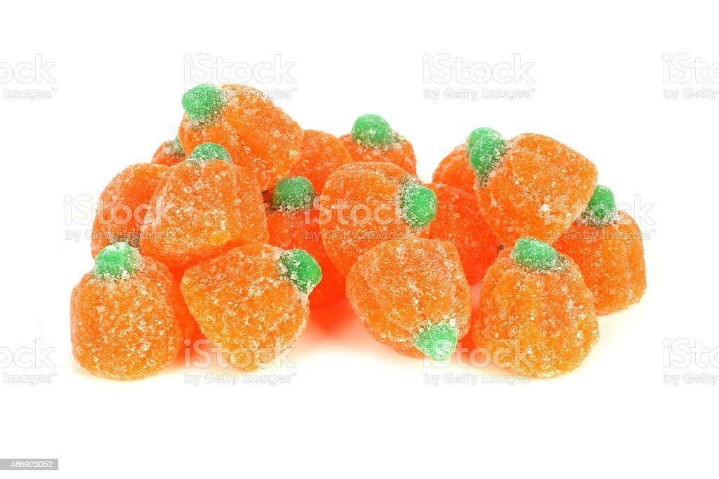 Pile of Halloween gummy pumpkin candies over white stock photo