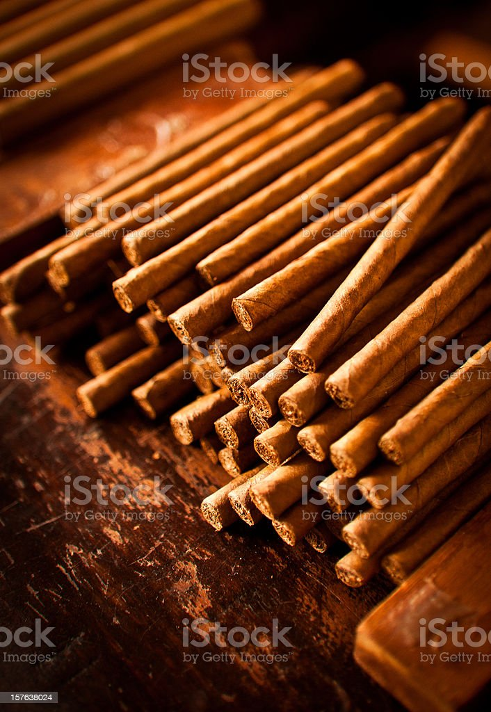 pile of hand made small cigars stock photo