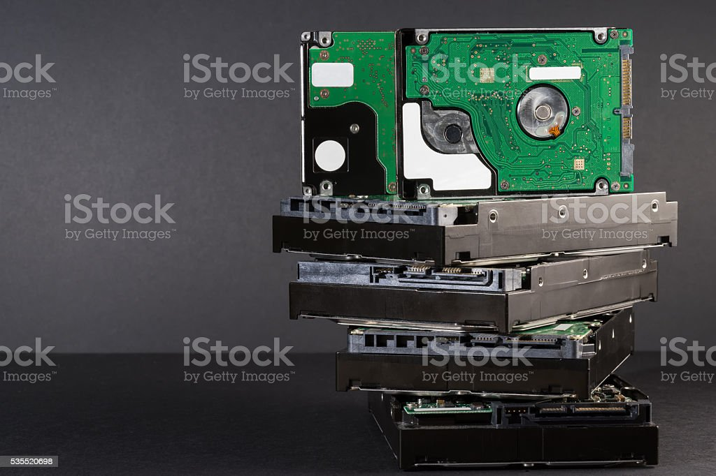 pile of hard drives at black background stock photo