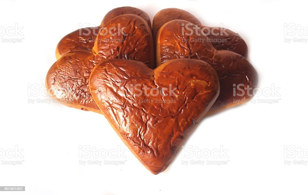 Pile of heart shaped biscuits isolated stock photo