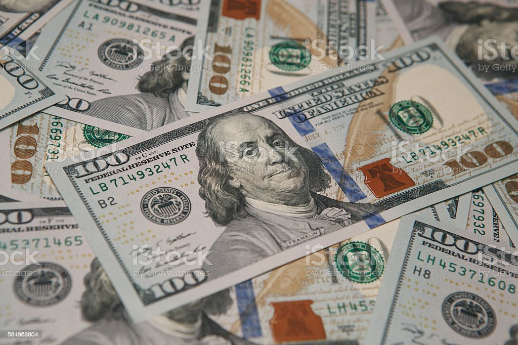 pile of hundred dollars bank notes stock photo