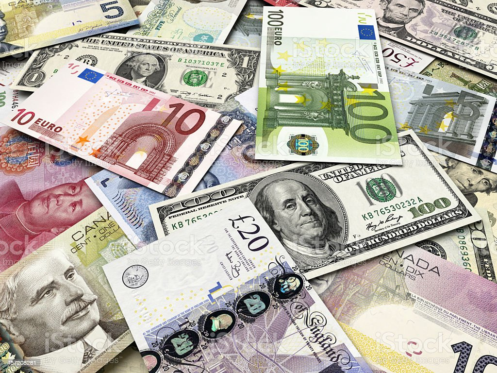 Pile of international currency bills stock photo