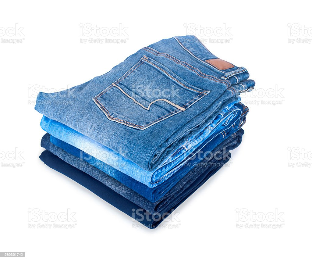pile of jeans on a white background stock photo