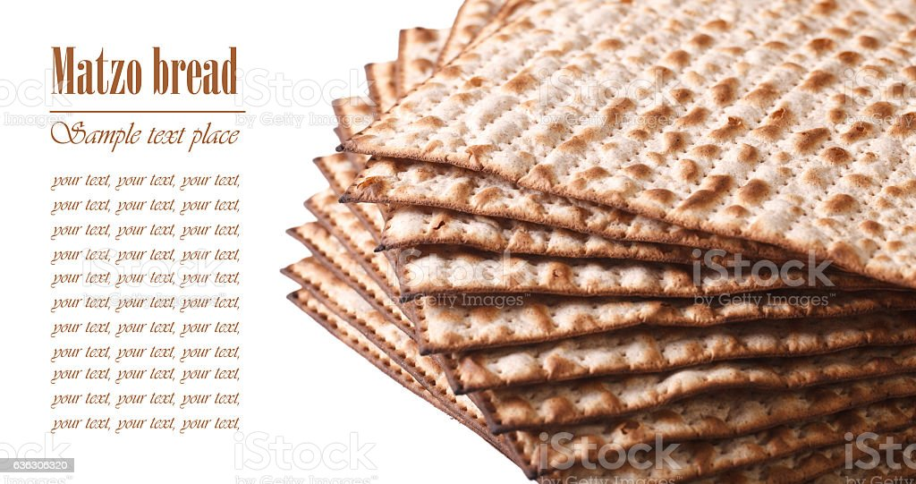 Pile of Jewish Matza Flatbread macro isolated on white horizontal stock photo