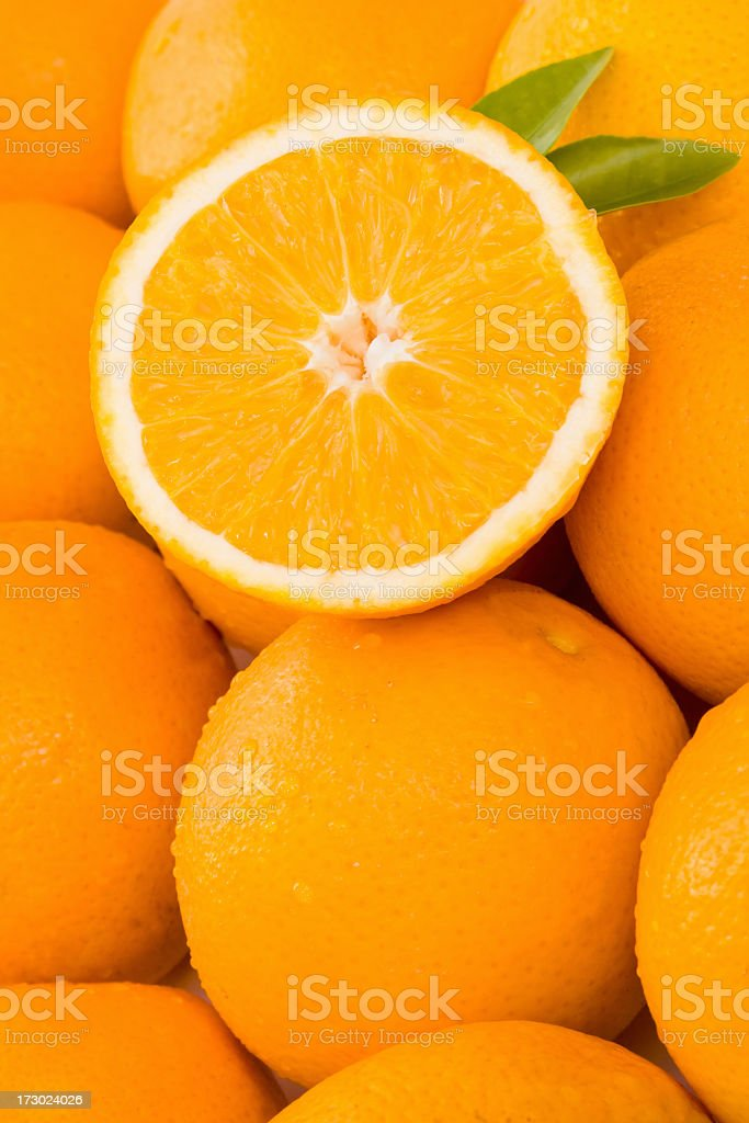 pile of juicy oranges royalty-free stock photo