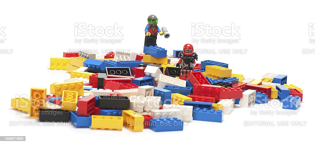 Pile of Lego Blocks with Astronaut Figurines on Top royalty-free stock photo