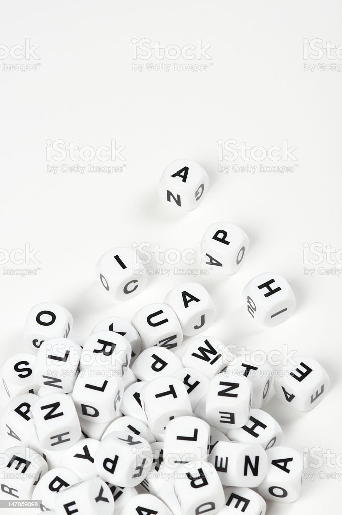Pile of letter cubes on white background royalty-free stock photo