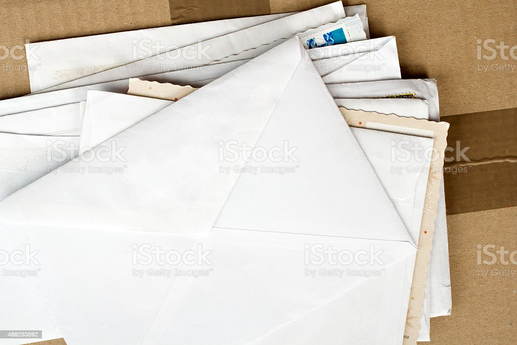 pile of letters and postal parcel stock photo