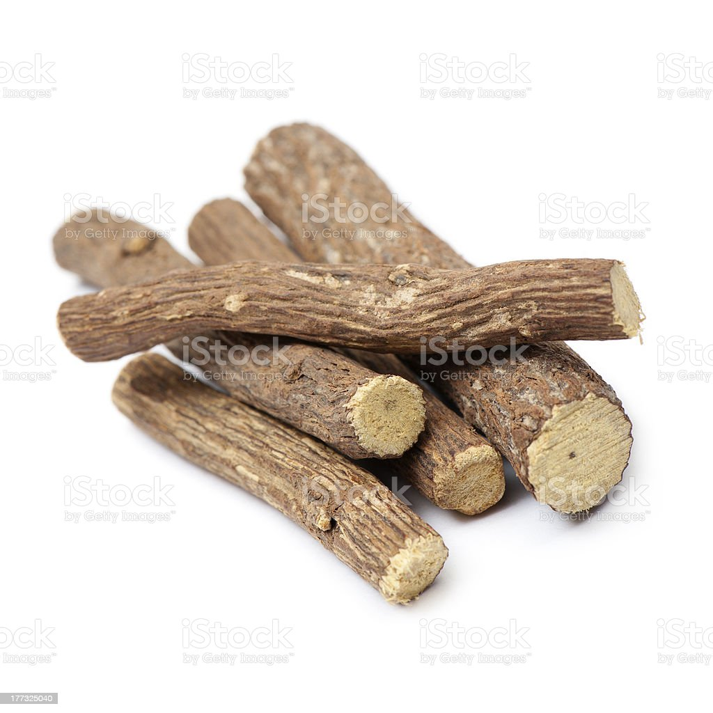 Pile of licorice roots on white background stock photo