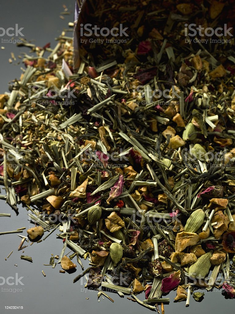 A pile of loose leaf mixed herbal tea on a dark background royalty-free stock photo