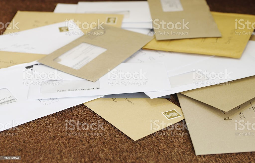 Pile Of Mail On Doormat stock photo