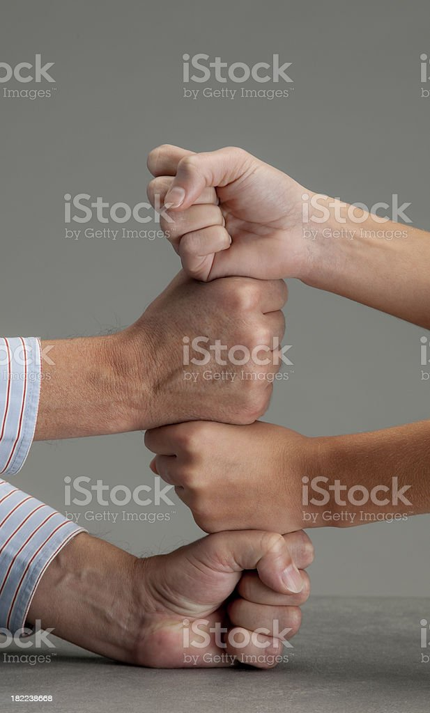pile of male and female fists XXL stock photo