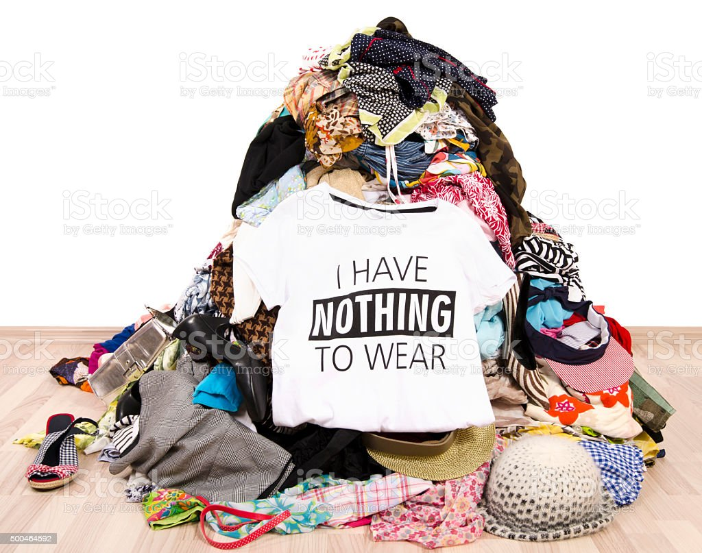 Pile of many clothes and a nothing to wear top. stock photo