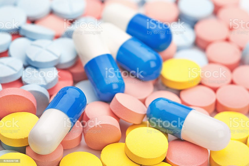 pile of medical pills, tablets of different colors stock photo