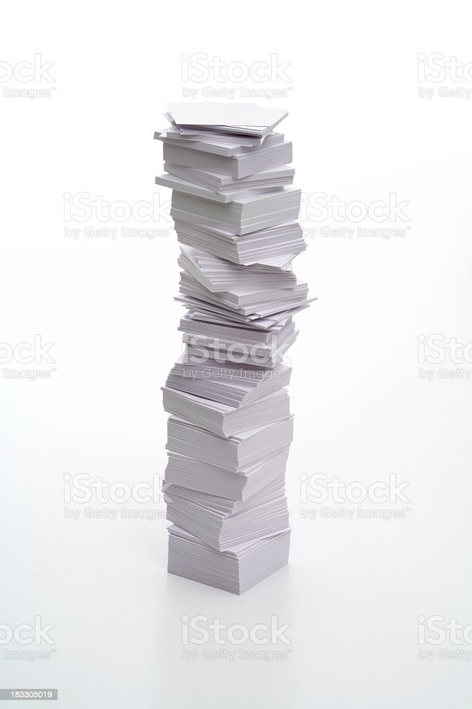 Pile of messily stacked white papers on white background stock photo