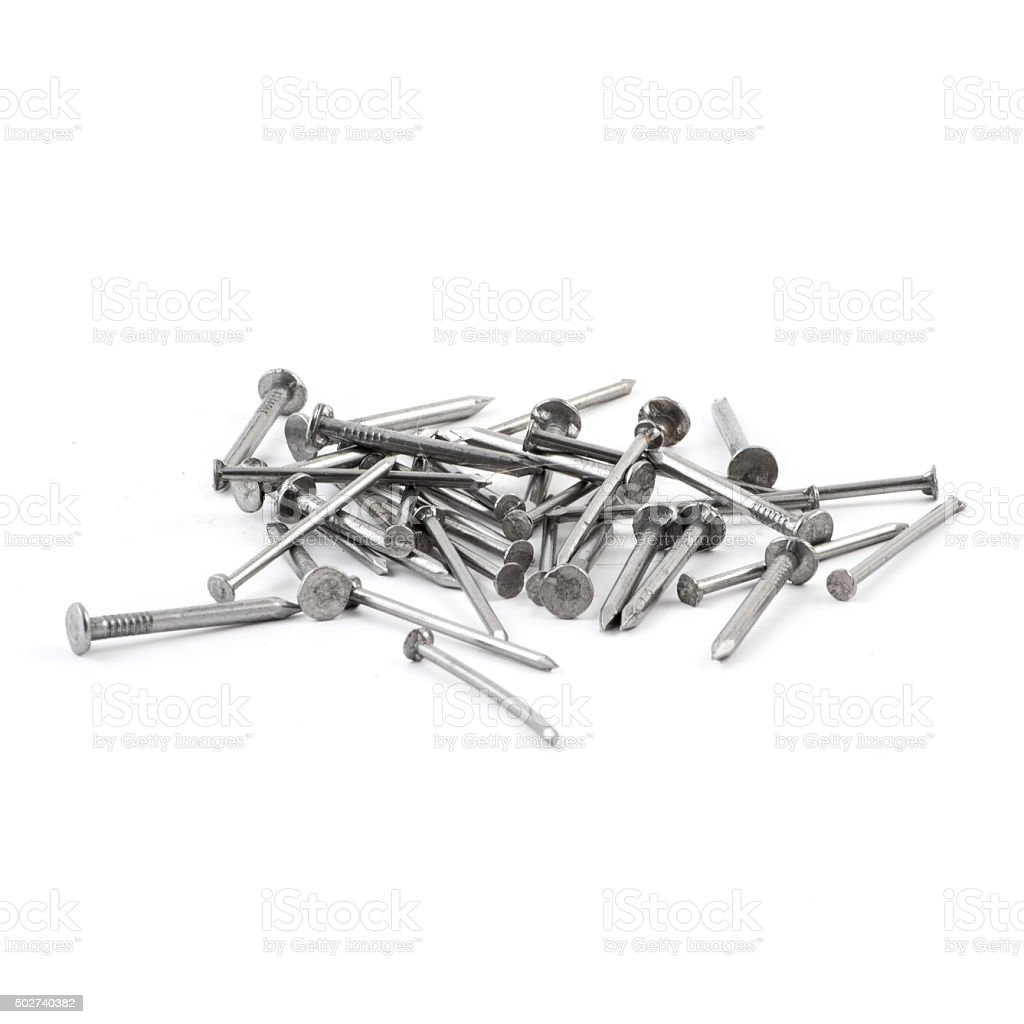 Pile of metal nails isolated over white background, view above stock photo