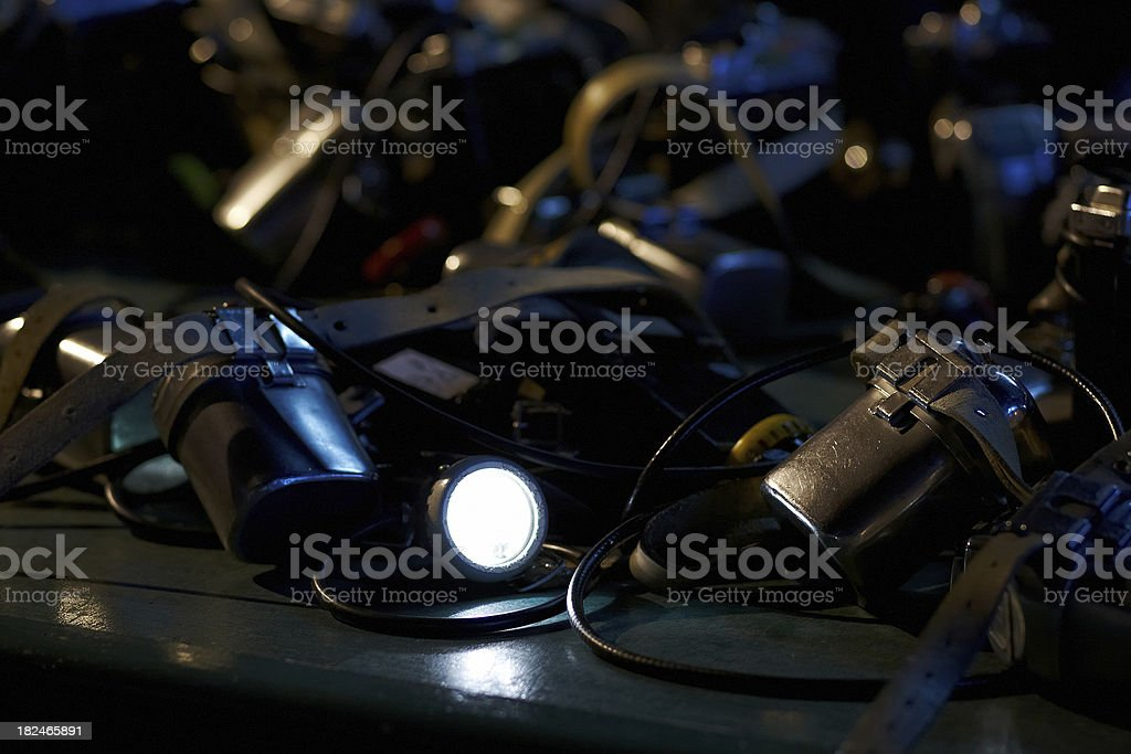 Pile of miners lamps one switched on stock photo
