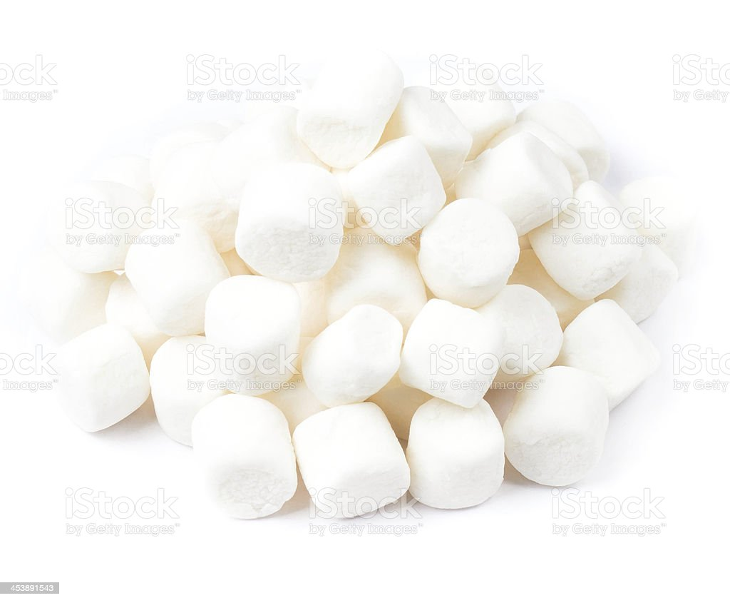 pile of mini white puffy marshmallows on  background. stock photo