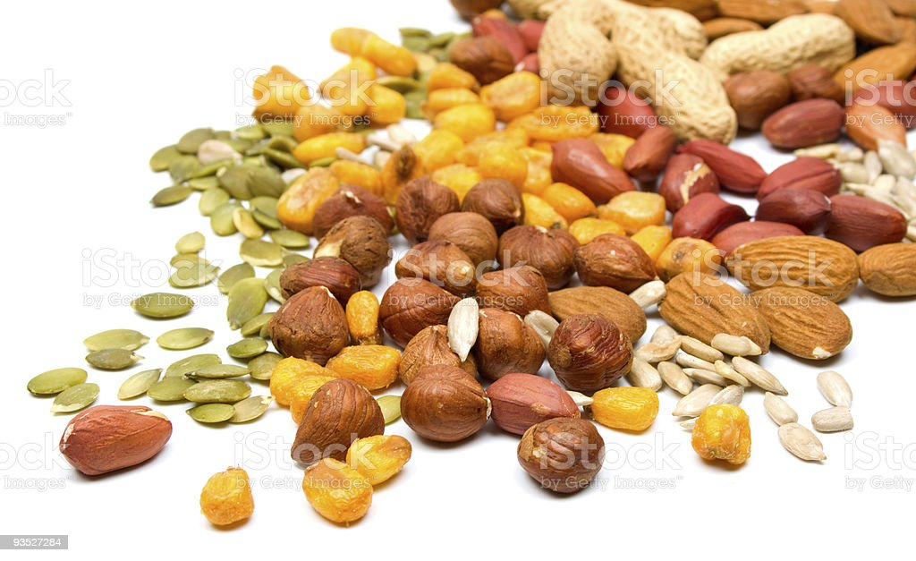 Pile of mixed nuts and seeds on white background royalty-free stock photo