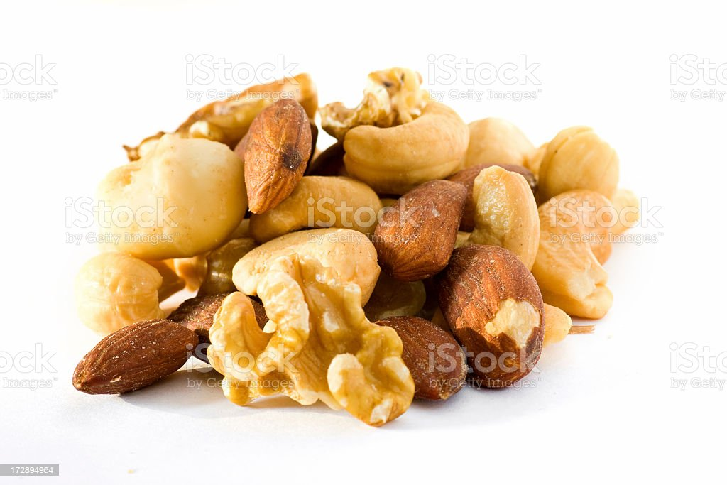 A pile of mixed nuts on a white background  royalty-free stock photo
