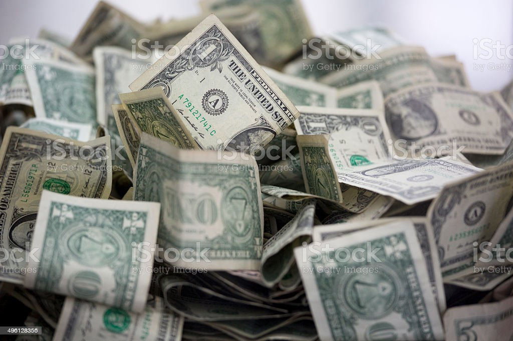 Pile of money in a charity donation box stock photo