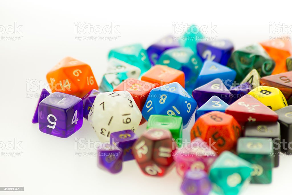 Pile of multicolored gaming dice on a white surface stock photo