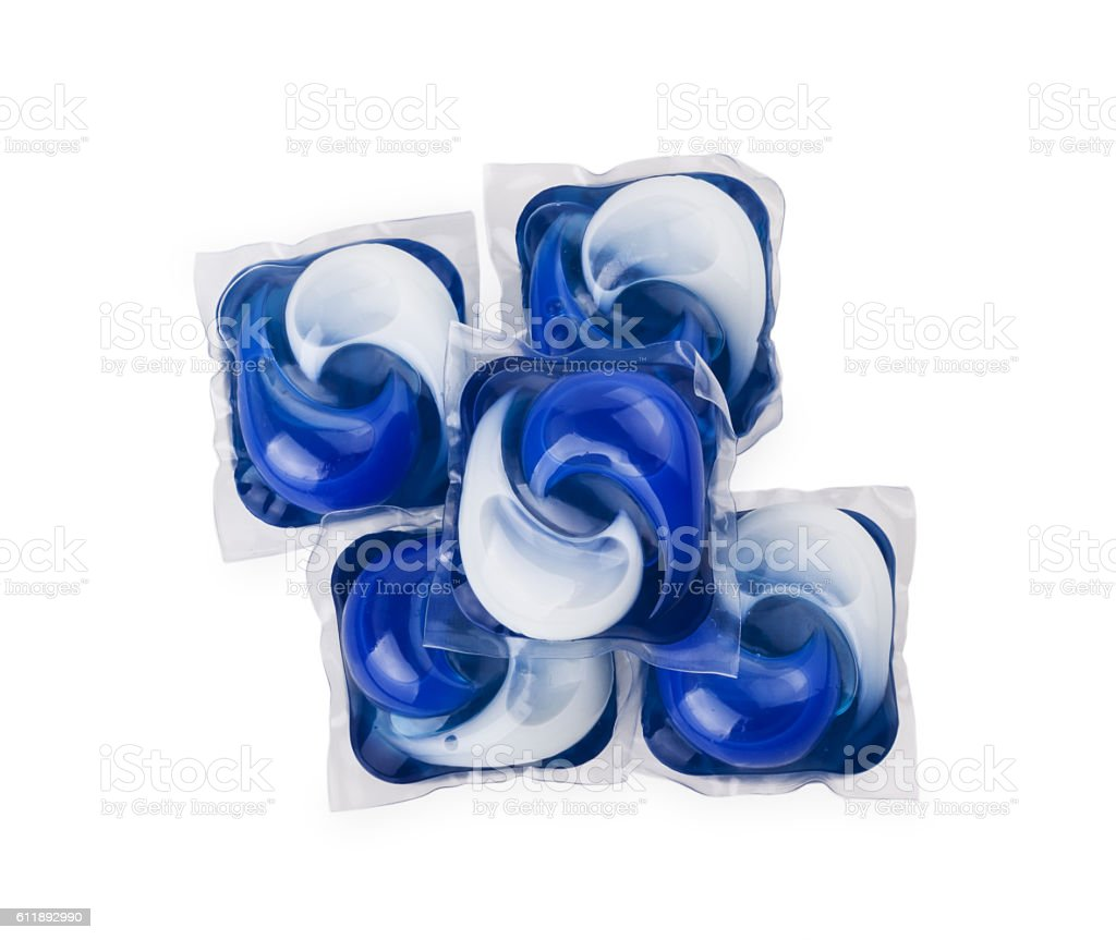 Pile of multiple washing pod capsules isolated over white stock photo