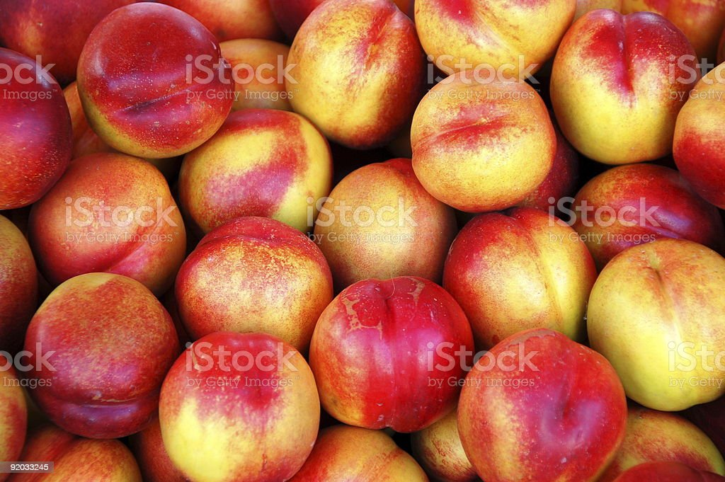 Pile of nectarines stock photo