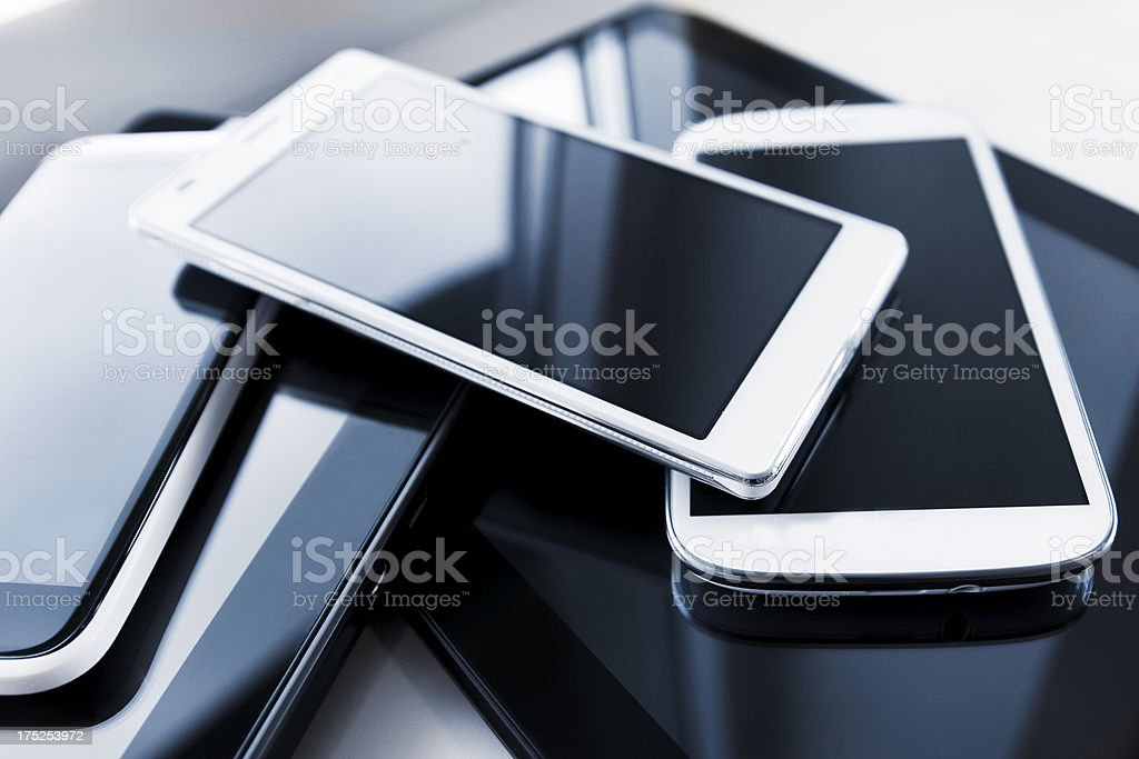 Pile of new mobile phones and digital tablets royalty-free stock photo