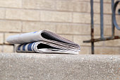 Pile of newspapers on a stairs
