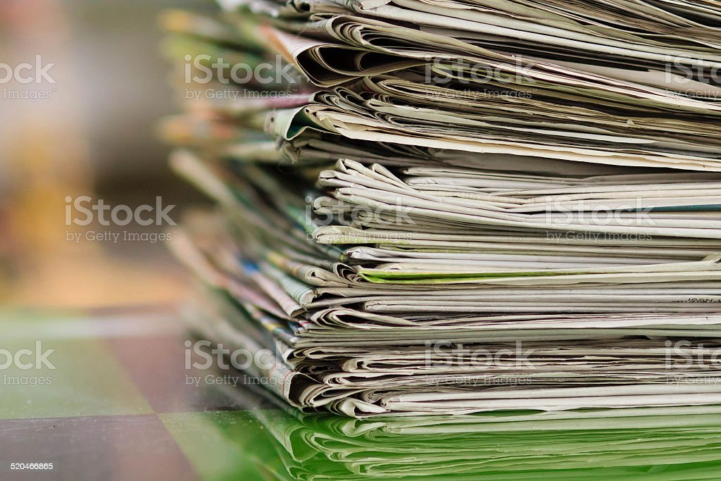 Pile of newspapers with space stock photo