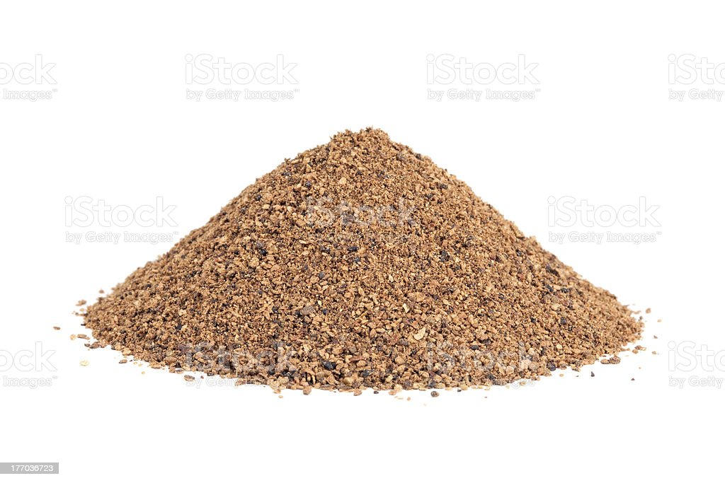 Pile of Nutmeg powder (Myristica fragrans) isolated on white stock photo