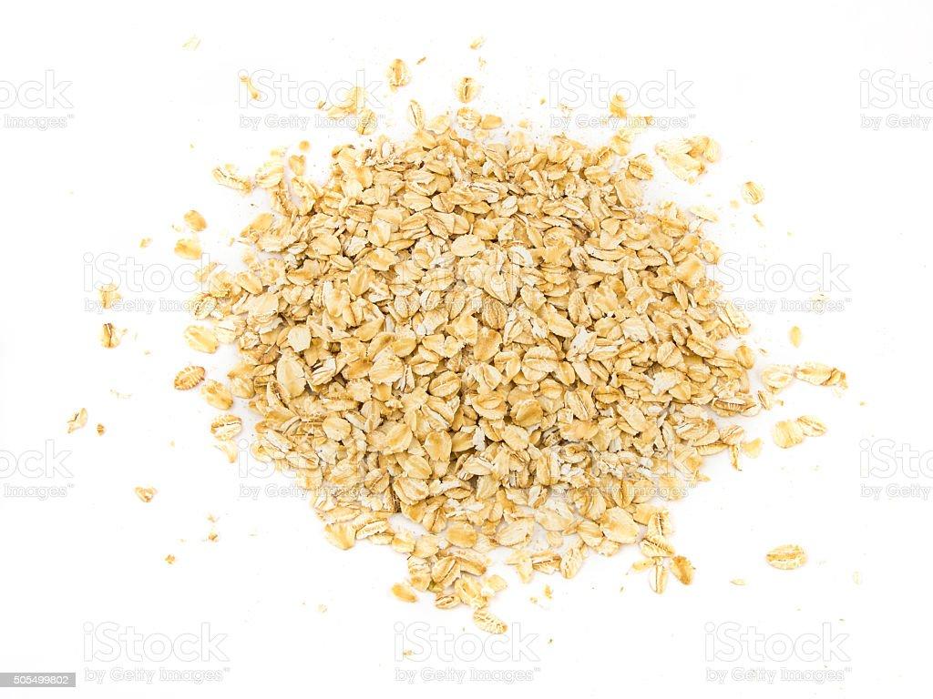 Pile of oatmeal isolated on white background stock photo
