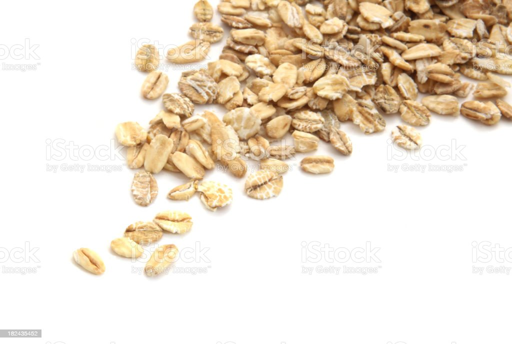 A pile of oats spilling into the picture stock photo