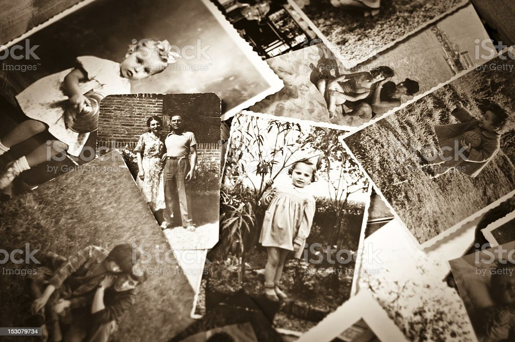 A pile of old black and white photographs stock photo