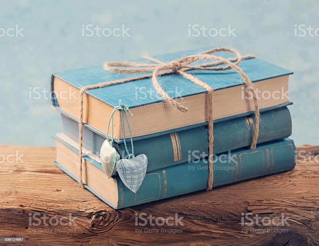 Pile of old blue books stock photo