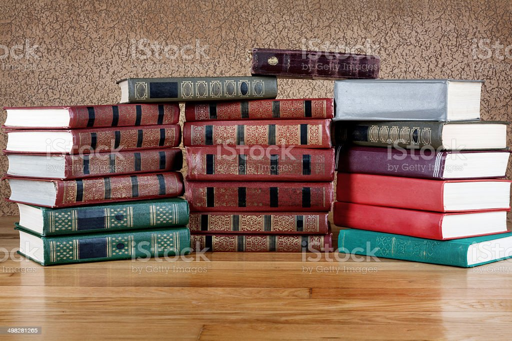 Pile of old books on a beautiful wooden table stock photo
