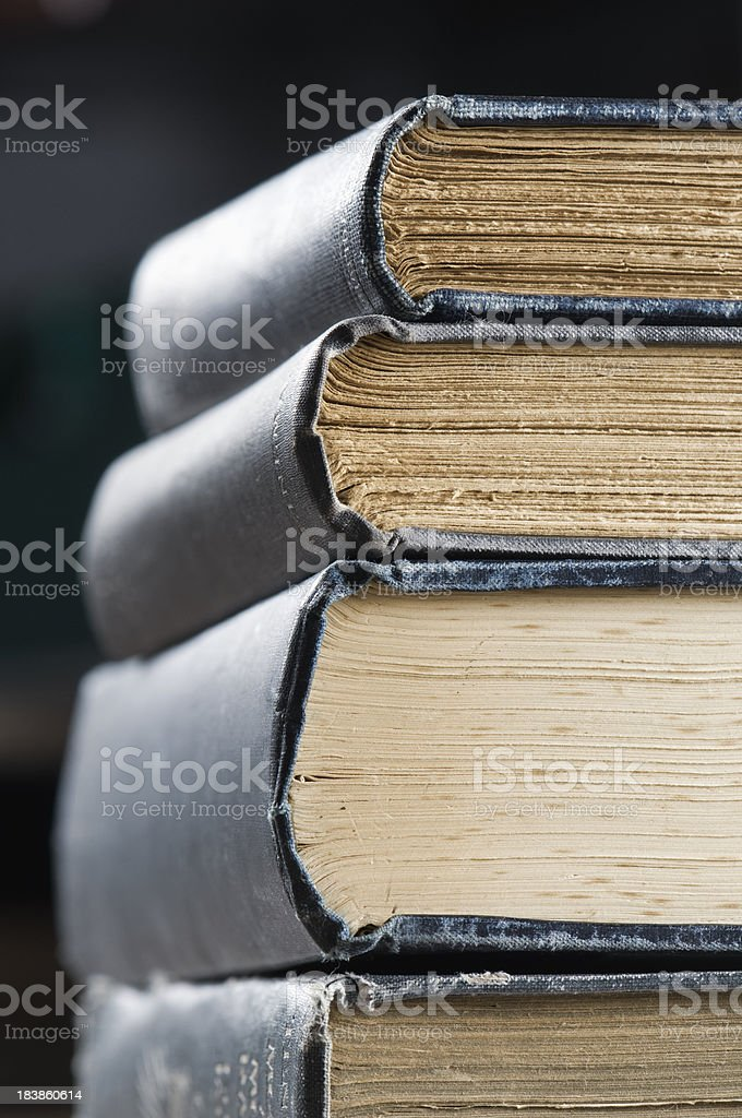 Pile of old books with vintage leather covers royalty-free stock photo