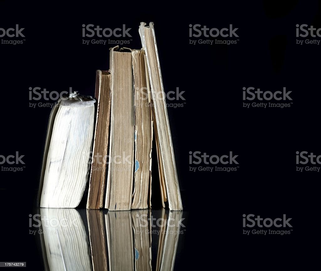 Pile of old books with vintage pages reflected royalty-free stock photo