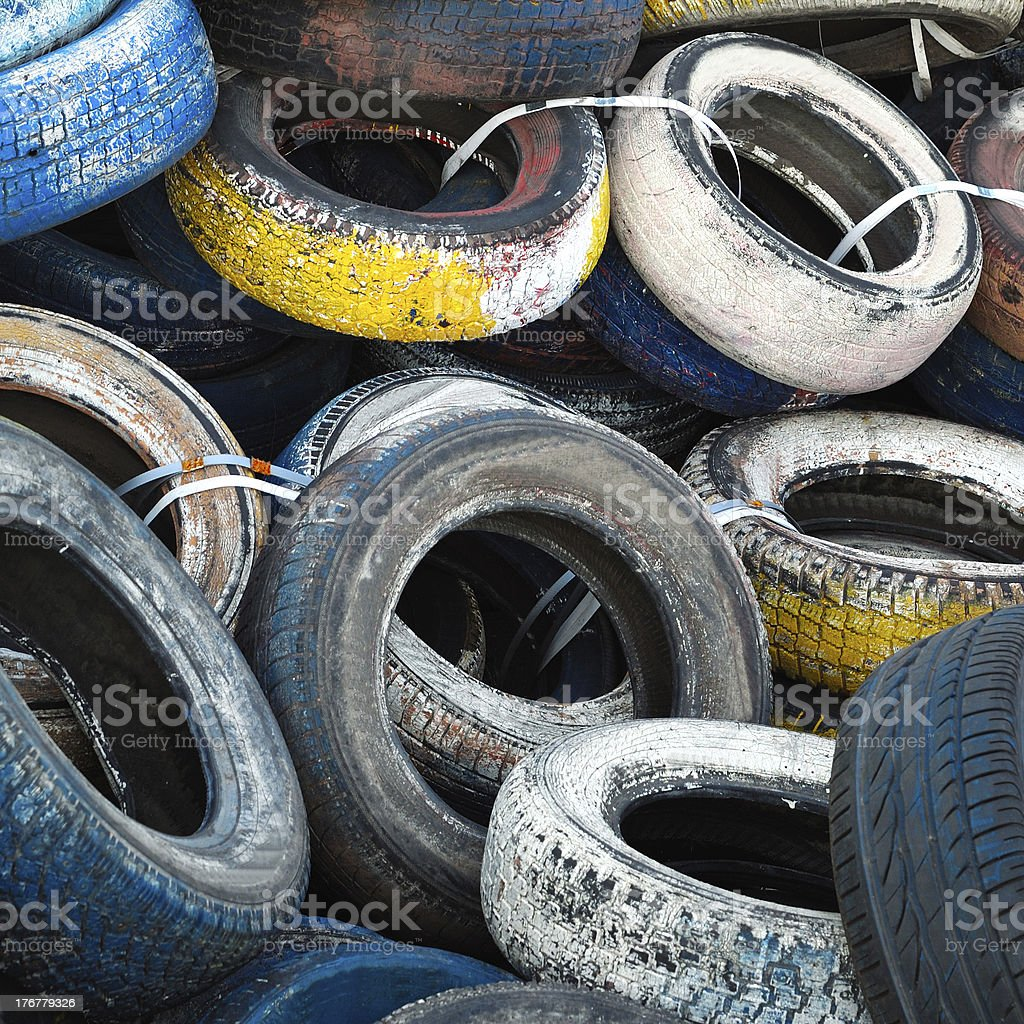 pile of old colored tires stock photo