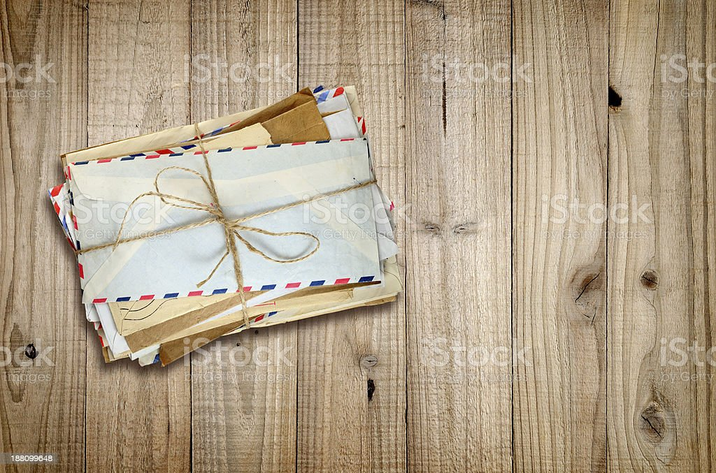 Pile of old envelopes on wood stock photo