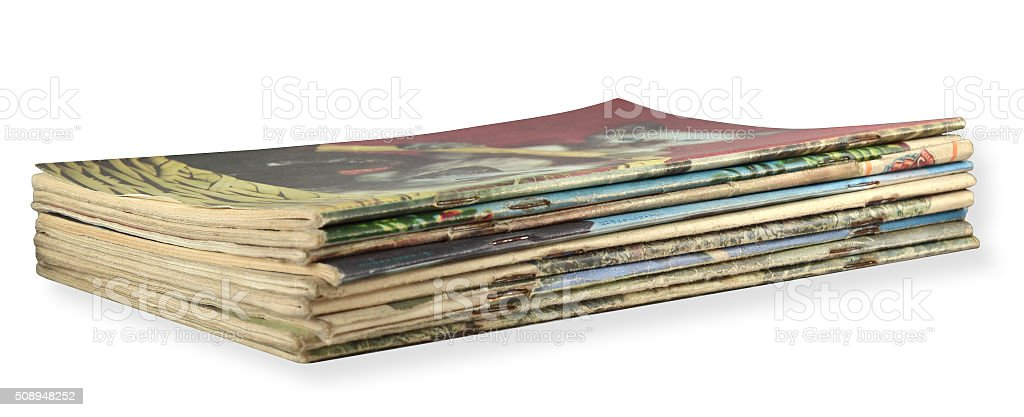 pile of old magazines stock photo