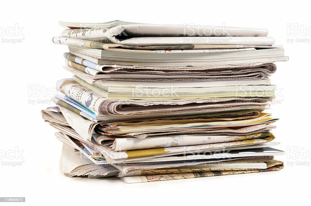 Pile of old newspapers and magazines stock photo