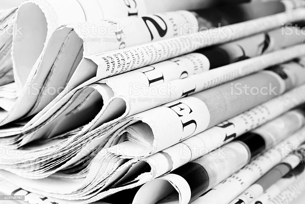 Pile of old newspapers, selective focus
