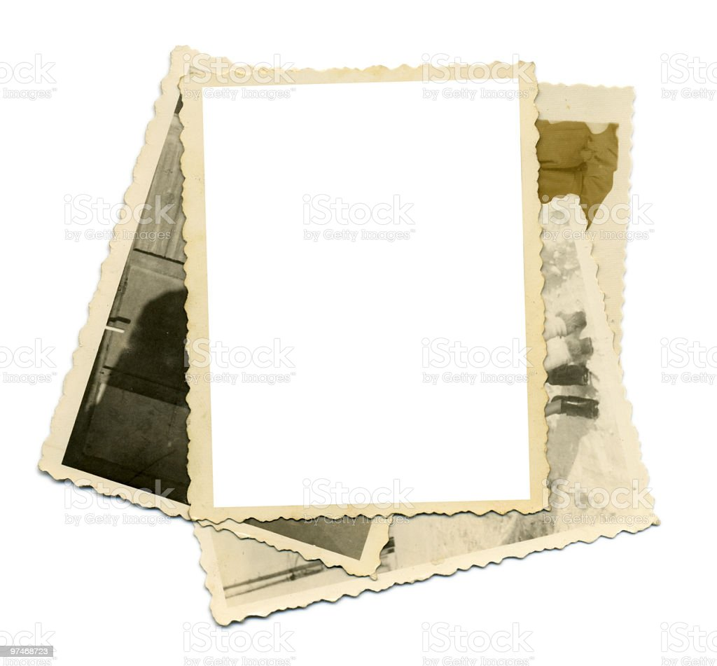 A pile of old photos with a blank photograph on top royalty-free stock photo