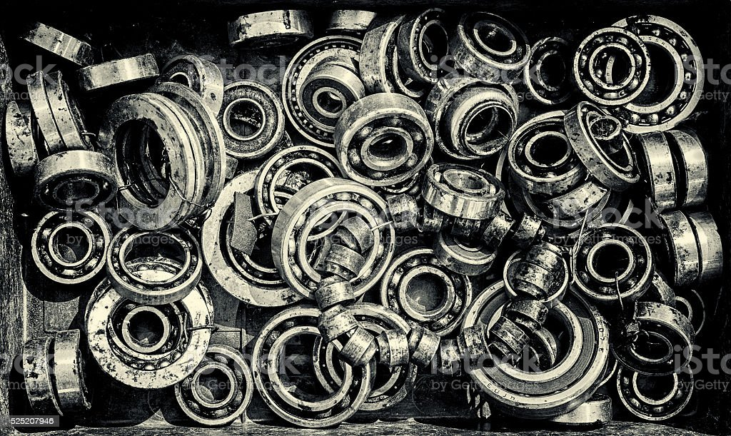 Pile of Old Rusty Ball Bearing Wheels stock photo