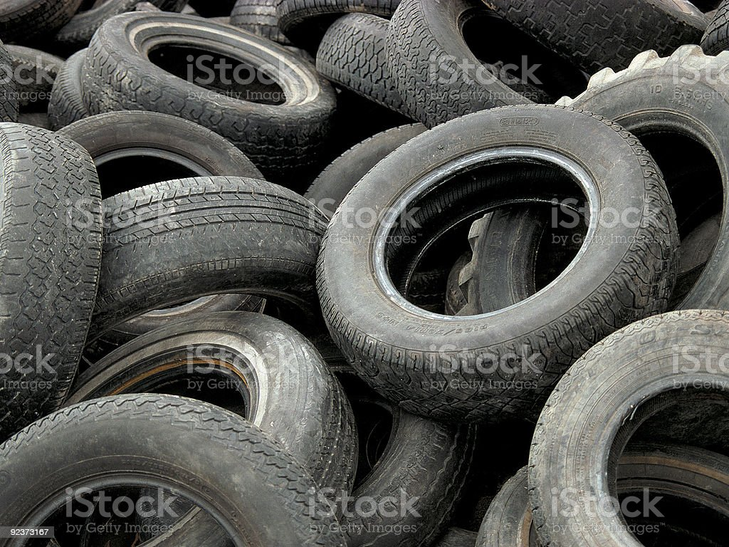 Pile of old tires stock photo